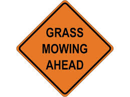 Grass Mowing Ahead Sign